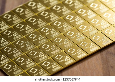 Medford, Oregon - November 04: Close up of a Valcambi gold bar perforated into breakable 1 oz pieces of gold. November 04, Medford, Oregon.