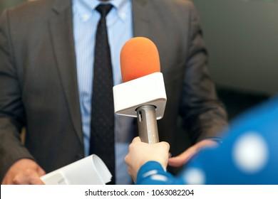 Media interview. Public relations - PR. Microphone.
