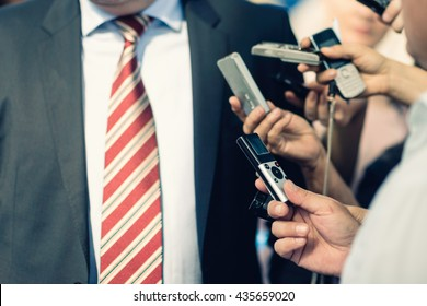 The Media - Journalists interviewing businessman
