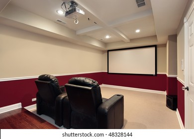 Media room in luxury home with home theater chairs