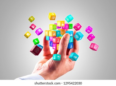 Media technology and internet networking web communication concept- Colorful icon cubes holding by hand.