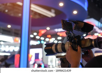Media Television film Production and interview reporter concept: Video recorder movie recording films shooting of grand opening in conference hall live event streaming for presentation by videographer