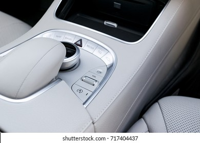 Media volume and navigation control buttons of a Modern car. Car interior details. White leather interior of the luxury modern car. Modern car interior