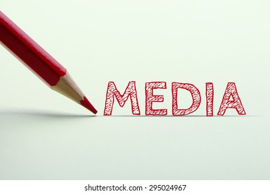 Media word is standing on the paper with red pencil aside.