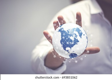 Media worldwide technology concept and Businessman hands carrying world map - rule the world, world domination concepts