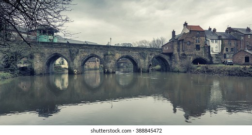 The mediaeval Elvet Bridge spanning the River Wear in Durham, North East England.