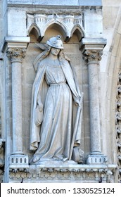Mediaeval figure of Synagoga on the west facade of Notre Dame cathedral in Paris, representing the Jewsih religion and its relationship with the christian faith in the figure of Ecclesia