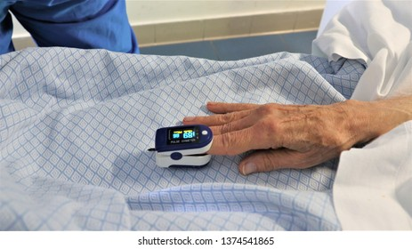 Medic and patient using finger pulse oximeter. Close-up
