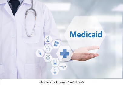 Medicaid Medicine doctor hand working  Professional doctor use computer and medical equipment all around, desktop top view