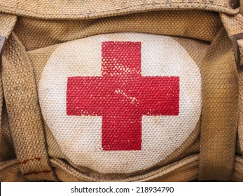 medical aid symbol on a vintage jute army bag