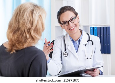 Medical appointment in female doctor's office, horizontal