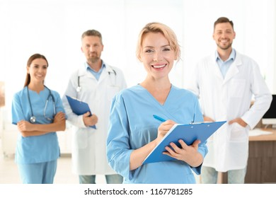 Medical assistant with colleagues in clinic. Health care service