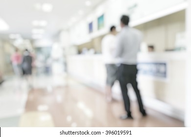 Medical blur background customer or patient service counter, office lobby, or bank business building interior inside waiting hall area