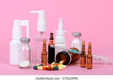 medical bottles isolated on pink background, drugs and
