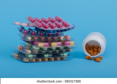 Medical bottles and pills on white