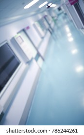 Medical building hallway, unfocused background.