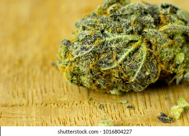 Medical  Cannabis - flower of cannabis on the fresh oak wood background.