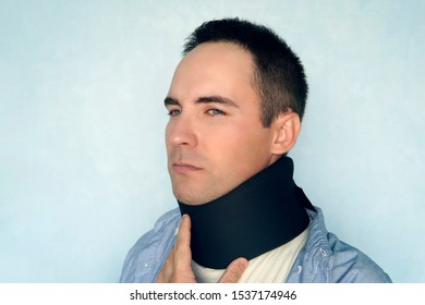 Medical cervical collar. a sick man with a black collar to fix a neck fracture. warm collar, warming up the throat.