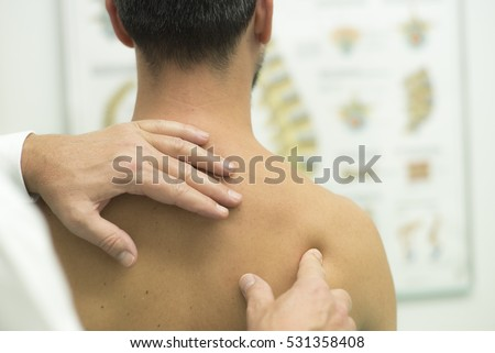 Medical check at the shoulder during a physiotherapy examination