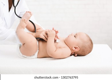 Medical check up. Pediatrician listening to baby's lungs and heart, close up