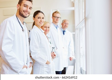 Medical clinic staff with group of doctors and assistants