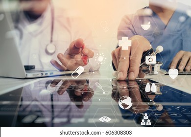 Medical co working concept,Doctor working with smart phone and digital tablet and laptop computer to meeting his team in modern office at hospital with virtual diagram