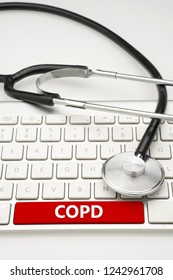 Medical concept. COPD (Chronic Obstructive Pulmonary Disease) text with medical device on white background.