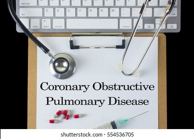 Medical Concept: Coronary Obstructive Pulmonary Disease with syringe, stethoscope, pill and keyboard