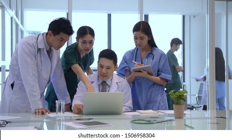 Medical concept. The doctor is dividing the duties for the team. 4k Resolution.