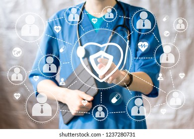 Medical concept doctor pushing button heart pulse security shield virus health care network on virtual panel.