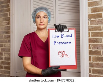 Medical concept meaning Low Blood Pressure with sign on the piece of paper.