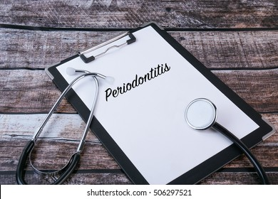 Medical Concept : Periodontitis written in clipboard with stethoscope on wooden background.