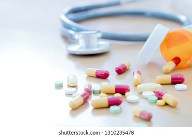 Medical concept with pills and stethoscope on table wooden