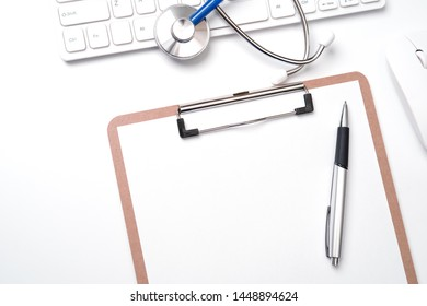 Medical Concept - Stethoscope on computer keyboard on white background. Physician long term care treatment concept. Top view, flat lay, copy space