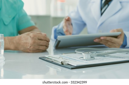 Medical Concept. Stethoscope on medical form with doctor and patient in clinic room.