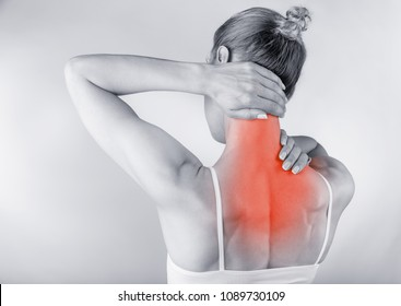 Medical concept. Woman with backache isolated on grey background