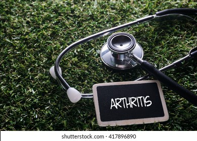 Medical Concept-Arthritis words written on label tag with Stethoscope on grass background
