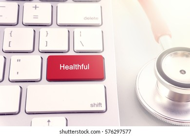 Medical concept-Healthful word on keyboard and stethoscope on white background.close up