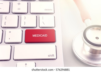 Medical concept-Medicaid word on keyboard and stethoscope on white background.close up