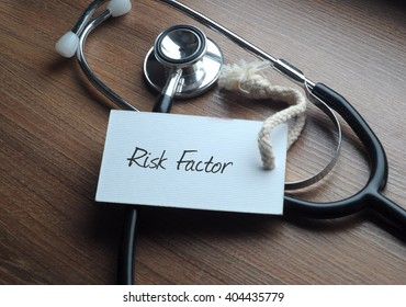Medical Concept-Risk Factor words written on label tag with Stethoscope on wood background