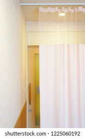 Medical curtain hanging from a railing in a hospital room, Privacy curtain
