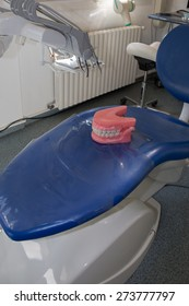 Medical denture jaws smile white teeth on dentist chair