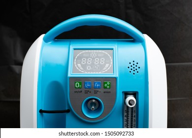 Medical Device Individual Blue White portable oxygen cylinder to put gas for patients with respiratory disorders, studio lighting black background