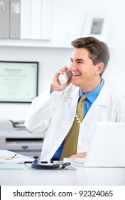 Medical doctor calling by phone at the hospital. Health care.