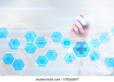 Medical doctor drawing on the virtual screen. Medical and healthcare concept.