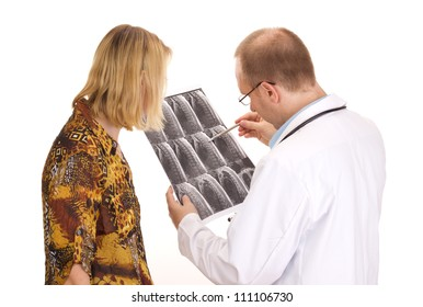 Medical doctor examining a patient