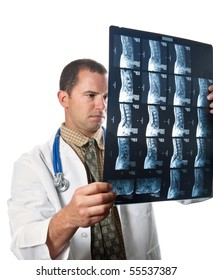 Medical Doctor holding up film scans of a patient's back and examining them.