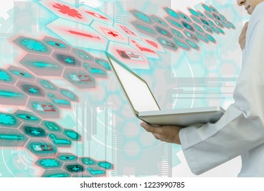 Medical doctor holding  laptop in  hand, and  analyzing patient data from cloud storage to analyze and process through hologram  with concept using technology to analyze and diagnose diseases.