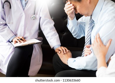 medical doctor holing senior patient's hands for encouragement cheering and support