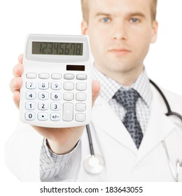 Medical doctor isolated on white with a calculator in his right hand showing calculated costs and revenues in physician practice and hospital fees - 1 to 1 ratio